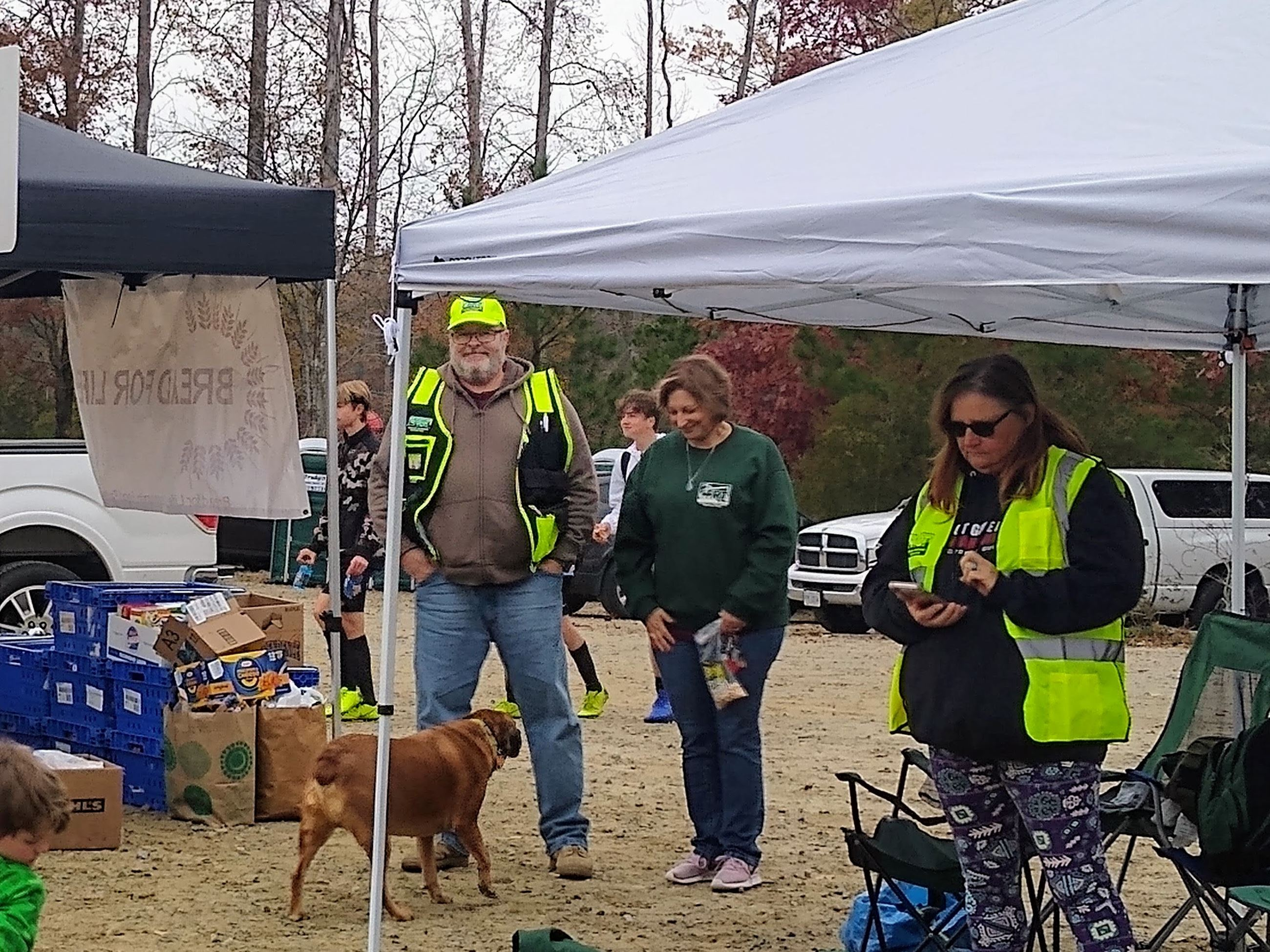 CERT members holding a first aid tent for annual Bird Bash.